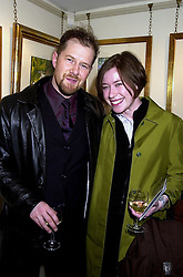 Fashion designer NEIL CUNNINGHAM and his sister MISS SUSIE CUNNINGHAM, at an exhibition in London on 2nd Novemebr 2000.OIS 13