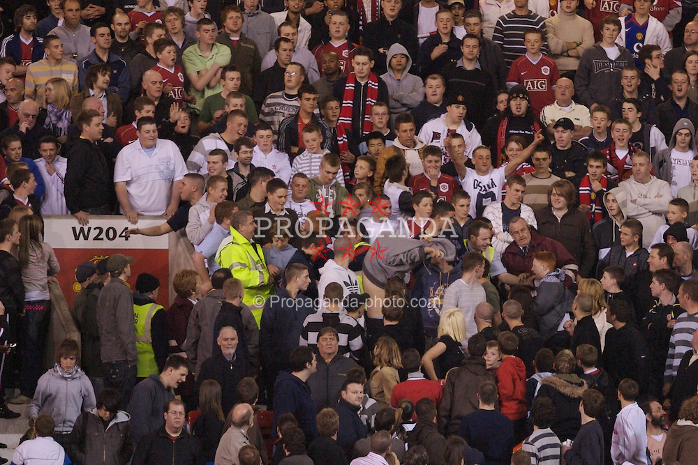 Manchester, England - Thursday, April 26, 2007: Stewards eject fans during the FA Youth Cup Final 2nd Leg at Old Trafford. (Pic by David Rawcliffe/Propaganda)