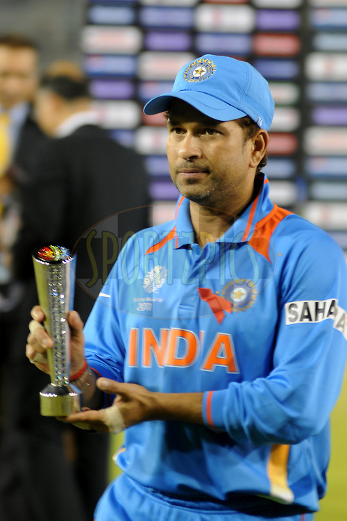 Sachin Tendulkar of India poses with the man of the match trophy after the ICC Cricket World Cup semi final match between India and Pakistan South Africa held at the Mohali Cricket Stadium in Mohali on the 30 March 2011..Photo by Pal Pillai/BCCI/SPORTZPICS