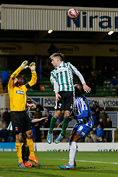 Jarrett Rivers of Blyth Spartans cant quite reach the corner ball to head a shot as Scott Flinders of Hartlepool United competes - Photo mandatory by-line: Rogan Thomson/JMP - 07966 386802 - 05/12/2014 - SPORT - FOOTBALL - Hartlepool, England - Victoria Park - Hartlepool United v Blyth Spartans - FA Cup Second Round Proper.