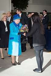 © Licensed to London News Pictures . 14/11/2013 . Manchester , UK . The Queen is presented with a bunch of flowers . Queen Elizabeth II and the Duke of Edinburgh visit the Coop building at 1 Angel Square , Manchester , this morning ( 14th November 2013 ) . Photo credit : Joel Goodman/LNP