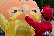 London, UK: The inflatable balloon called Baby Trump is almost readt to fly above Parliament Square in Westminster, the seat of the UK Parliament, during the US President's visit to the UK, on 13th July 2018, in London, England. Baby Trump is a 20ft high orange blimp depicting the US President as an enraged, smartphone-clutching infant - and given special permission to appear above the capital by London Mayor Sadiq Khan because of its protest rather than artistic nature. It is the brainchild of Graphic designer Matt Bonner. Photo by Richard Baker / Alamy Live News