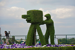 LONDON, ENGLAND - Thursday, June 24, 2010: A bush cut as a TV camera man on the broadcast centre on day four of the Wimbledon Lawn Tennis Championships at the All England Lawn Tennis and Croquet Club. (Pic by David Rawcliffe/Propaganda)