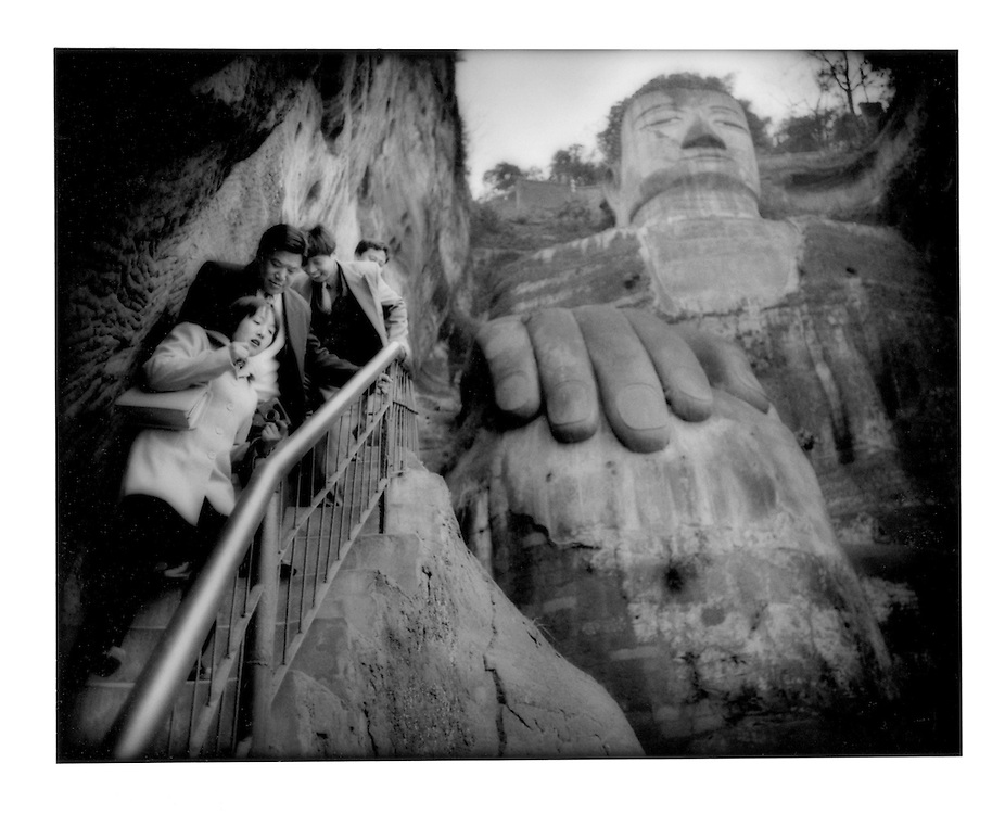 "Tourist descend the stairs beside ""Dafu"", the Great Buddha.  Leshan, Sichuan Province, China.  2001"