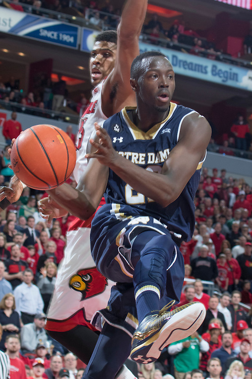 Notre Dame guard Jerian Grant, right, drives around Louisville guard/forward Wayne Blackshear in the second half. <br /> <br /> The University of Louisville hosted Notre Dame, Wednesday, March 04, 2015 at Yum Center in Louisville. <br /> <br /> Photo by Jonathan Palmer