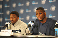 Ole Miss' Nick Williams (left) and Ole Miss' Murphy Holloway (31) attend a press conference at the NCAA Tournament at the Sprint Center in Kansas City, Mo. on Saturday, March 23, 2013. Ole Miss plays La Salle on Sunday.