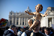 Vatican City dec 20th 2015, the pope blesses Baby Jesus figurines in St Peter's Square, during the Angelus prayer. In the picture a figurine