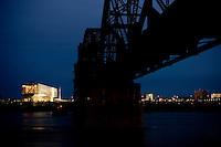 William J. Clinton Presidential Library and pedestrian bridge at dusk in Little Rock, Arkansas.