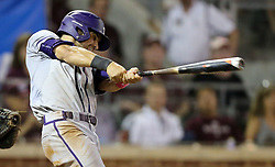 TCU's Ryan Merrill (5) hits a two rbi double against Texas A&M's during the 5th inning of a NCAA college baseball super regional tournament game, Friday, June 10, 2016, in College Station, Texas. (AP Photo/Sam Craft)