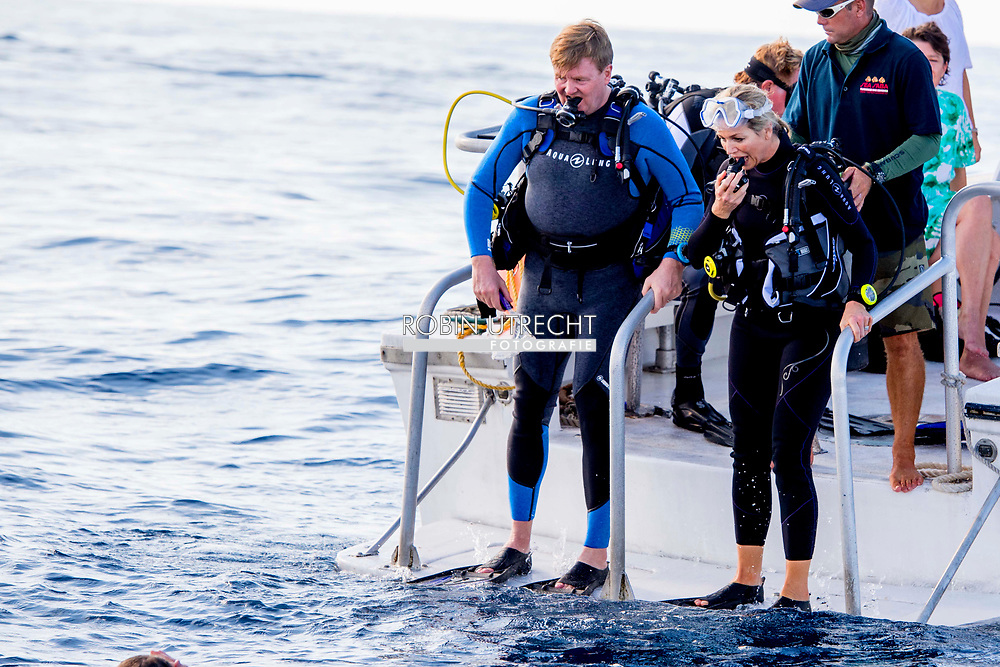 THE BOTTOM - King Willem-Alexander and Queen Maxima dive into the water during a cruise to view the vulnerable nature and coral reefs of the Saba Bank. ROBIN UTRECHT **