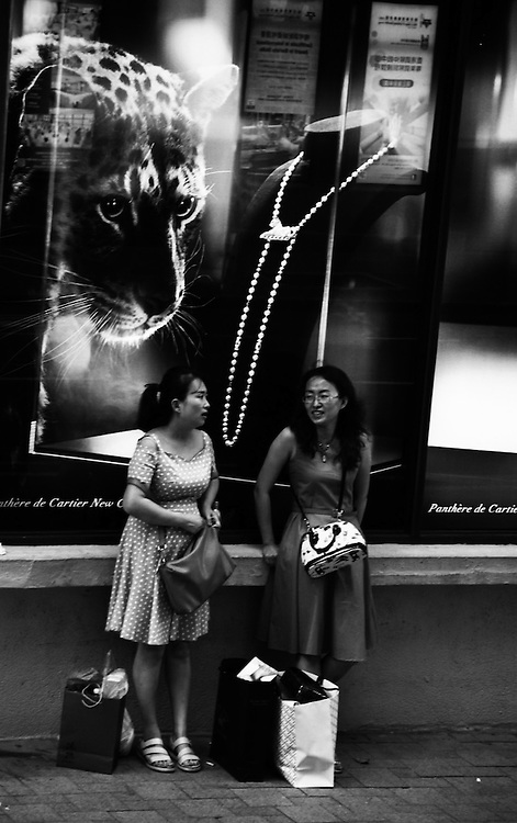 Happy Time by Tara Pangestu.<br /> <br /> Tara Pangestu works in Hong Kong as a domestic helper. Being a minority in Hong Kong has made her distinctly curious about the world around her. She found a voice and a sense of belonging when she started taking photographs of the city&rsquo;s busy streets.