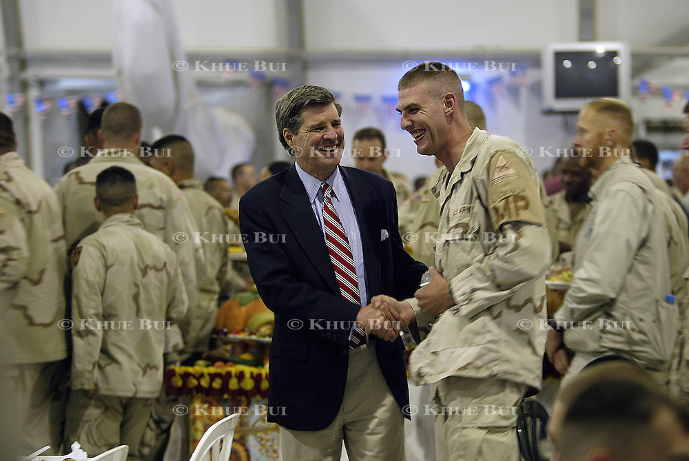 Iraqi Administrator Paul Bremer spends Thanksgiving dinner with troops of the 1st Armor Division in a mess hall at Baghdad International Airport Thursday, November 27, 2003.  In a clandestine night time move President Bush, with the knowledge of only a handful of senior staff, departed his ranch in Crawford, Texas and flew through the night to spend the Thanksgiving Day holiday visiting troops stationed in the war torn country...Photo by Khue Bui