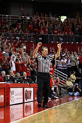 13 February 2013:  referee Rick Hartzell signals a three point goal was good during an NCAA Missouri Valley Conference mens basketball game where the Bradley Braves were defeated by Illinois State Redbirds 79-59 in Redbird Arena, Normal IL