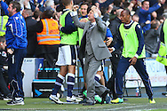 Ian Holloway , Manager of Millwall (centre) celebrates his team scoing the opening goal during the Sky Bet Championship match at The Den, London<br /> Picture by David Horn/Focus Images Ltd +44 7545 970036<br /> 03/05/2014