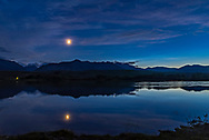 The waxing crescent Moon, and Venus (just above the mountain ridge) and, to the right, noctilucent clouds glowing low in the north over the Waterton River at the Maskinonge picnic area in Waterton Lakes National Park, Alberta on June 17, 2018. The Moon is beside Regulus in Leo.<br /> <br /> There was no wind this night, rare for Waterton. <br /> <br /> This is a high dynamic range stack of 5 exposures from dark to light, blended with Adobe Camera Raw. Taken with the Nikon D750 and Sigma 20mm lens. Additional contrast enhancement applied using Zone System Express 5 Photoshop extension and &ldquo;Enhanced Contrast&rdquo; function.
