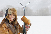 Smiling Woman with Cross-country Skis