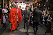 Costumed St Georges gather in the undervover Leadenhall Market in the City of London, on England's national St George's Day the 23rd April,
