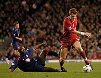 Photo. Jed Wee.Digitalsport<br /> Liverpool v Portsmouth, FA Barclaycard Premiership, Anfield, Liverpool. 17/03/2004.<br /> Liverpool's John Arne Riise (R) gets away from Portsmouth's Lomana Lua Lua.