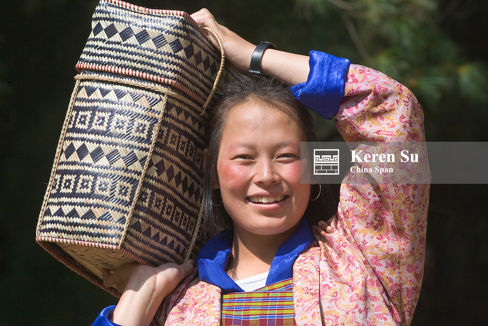 Girl carrying basket, Bhutan