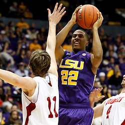 November 12, 2011; Baton Rouge, LA; LSU Tigers guard Ralston Turner (22) shoots over Nicholls State Colonels guard Chris Talkington (11) and guard Ben Martin (4) during the second half of a game at the Pete Maravich Assembly Center. LSU defeated Nicholls State 96-74.  Mandatory Credit: Derick E. Hingle-US PRESSWIRE