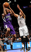 Sacramento Kings' Travis Outlaw (25) leaps to shoot over Brooklyn Nets' Deron Williams (8) during an NBA basketball game on Sunday, March 9, 2014 at Barclays Center in New York. (AP Photo/Kathy Kmonicek)
