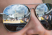 UNITED KINGDOM, London: 31 July 2015 The reflection of a game of Beach Rugby can be seen in the reflection of a spectators glasses in the heart of London this afternoon at Finsbury Square. The five-a-side rugby tournament imported 240 tonnes of sand for the event, which sees more than 300 rugby players come together and raise money for Help for Heroes. Rick Findler / Story Picture Agency.