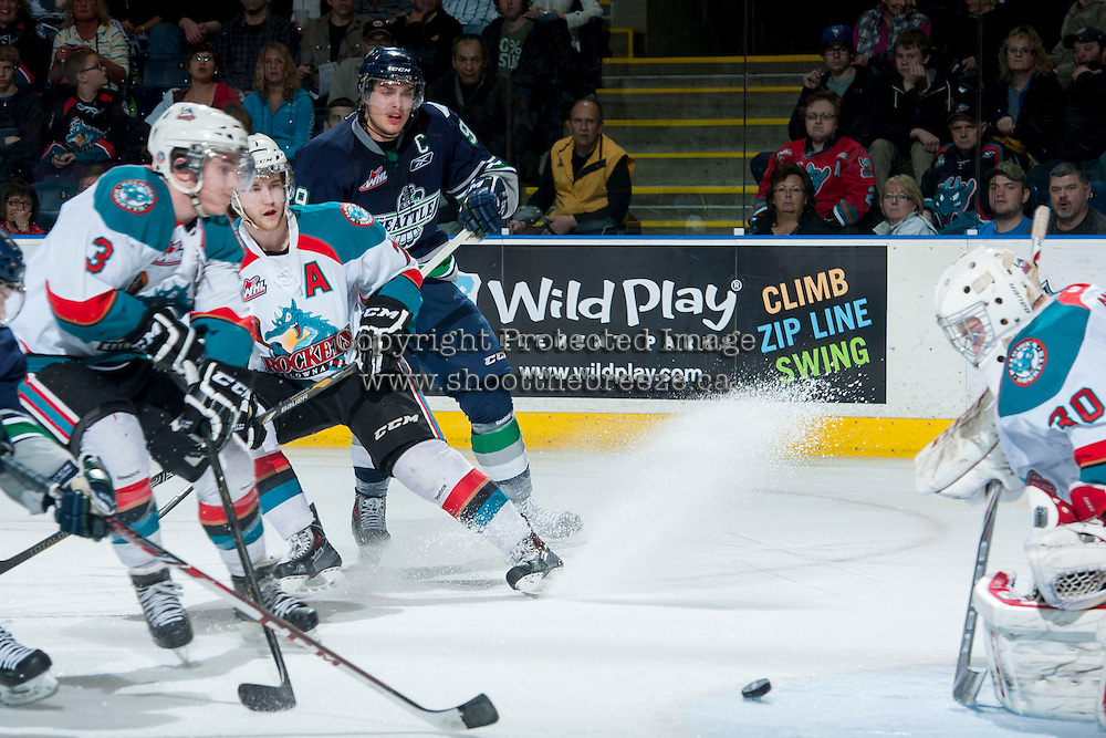 KELOWNA, CANADA - APRIL 5: Justin Hickman #9 of the Seattle Thunderbirds watches the puck as it approaches Jordon Cooke #30 of the Kelowna Rockets on April 5, 2014 during Game 2 of the second round of WHL Playoffs at Prospera Place in Kelowna, British Columbia, Canada.   (Photo by Marissa Baecker/Getty Images)  *** Local Caption *** Justin Hickman; Jordon Cooke; Damon Severson;