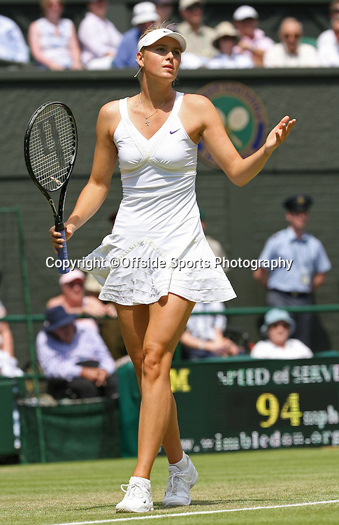24/06/2009. The All England Lawn Tennis Championships. Maria Sharapova cuts a forlorn figure during her 2nd round defeat to Gisela Dulko. Wimbledon, UK. Photo: Offside/Steve Bardens.