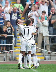 SWANSEA, WALES - Sunday, October 2, 2011: Swansea City's Danny Graham celebrates scoring the second goal against Stoke City during the Premiership match at the Liberty Stadium. (Pic by David Rawcliffe/Propaganda)