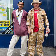 Man in combat fatigues with female friend in Page Hall Road, Sheffield.