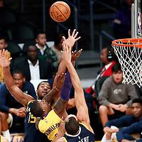 10 October 2017: Los Angeles Lakers guard Kentavious Caldwell-Pope (1) goes for the layup past Utah Jazz forward Derrick Favors (15) and Utah Jazz center Rudy Gobert (27) during the Utah Jazz 105-99 victory over the LA Lakers, at the Staples Center, Los Angeles, California, USA.