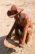 Metal sculpture of a gold miner by Ricardo Breceda at Galleta Meadows Estate, Borrego Springs, California USA
