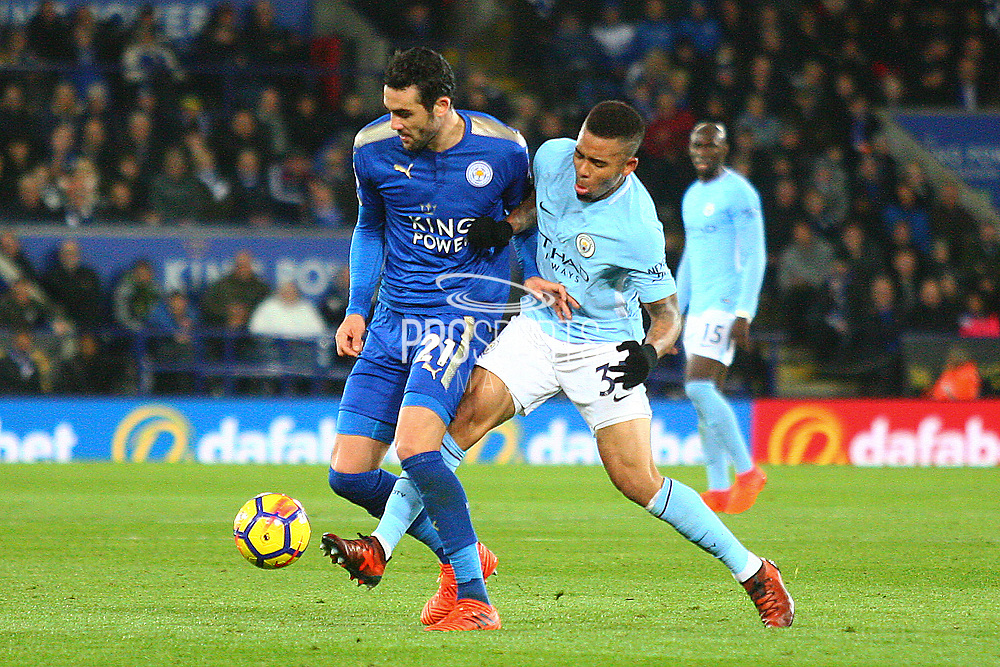 Leicester City midfielder Vicente Iborra (21) and Manchester City striker Gabriel Jesus (33) during the Premier League match between Leicester City and Manchester City at the King Power Stadium, Leicester, England on 18 November 2017. Photo by John Potts.