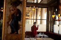 Le Grand Vefour, Paris, setting up the tables, - Photograph by Owen Franken