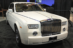 11 February 2009:  2009 ROLLS-ROYCE PHANTOM: One of the most opulent and luxurious vehicle on the road is the Rolls-Royce Phantom 4-door sedan. Bold and distinctive features include the chrome plated aluminum grille, long hood, and Spirit of Ecstasy mascot. A long wheelbase is crucial to achieve the classic Rolls-Royce look; and the roofline needs to blend into a wide 'C' pillar. The 5-passenger Phantom features rear-hinged coach doors, discreet rear window, and the diameter of the 21-inch wheel and tires are roughly half the height of the car. At the heart Phantom is an all-aluminum V-12 that produces 453hp and an incredible 531 lb ft of torque. With a gross vehicle weight of 6724lbs, the Phantom can still fly from 0-60mph in just 5.7sec and reach a top speed of 149mph..The Chicago Auto Show is a charity event of the Chicago Automobile Trade Association (CATA) and is held annually at McCormick Place in Chicago Illinois.