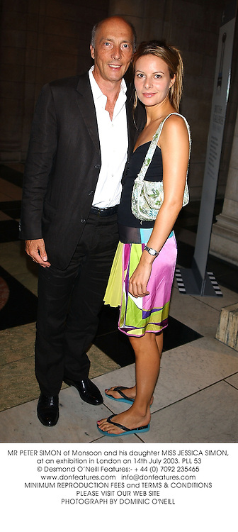MR PETER SIMON of Monsoon and his daughter MISS JESSICA SIMON,  at an exhibition in London on 14th July 2003.PLL 53
