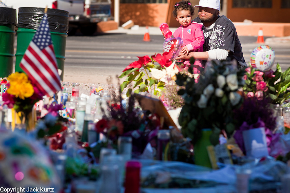 "15 JANUARY 2010 - TUCSON, AZ:   The memorial at Congresswoman Gabrielle Giffords office for victims of the mass shooting in Tucson, AZ, Saturday, January 15. Six people were killed and 14 injured in the shooting spree at a ""Congress on Your Corner"" event hosted by Arizona Congresswoman Gabrielle Giffords at a Safeway grocery store in north Tucson on January 8. Congresswoman Giffords, the intended target of the attack, was shot in the head and seriously injured in the attack but is recovering. Doctors announced that they removed her breathing tube Saturday, one week after the attack. The alleged gunman, Jared Lee Loughner, was wrestled to the ground by bystanders when he stopped shooting to reload the Glock 19 semi-automatic pistol. Loughner is currently in federal custody at a medium security prison near Phoenix.     PHOTO BY JACK KURTZ"