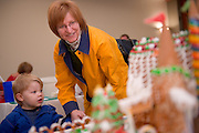 19149West 82's Gingerbread decorating contest on: Judging 12/9/08...Jill Russ and Ethan Russ, 2(Jill Russ's child)