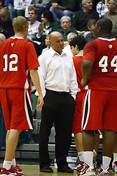 29 January 2011: Bosko Djurickovic looks disappointed as his players approach for a timeout during an NCAA basketball game between the Carthage Reds and the Illinois Wesleyan Titans at Shirk Center in Bloomington Illinois.