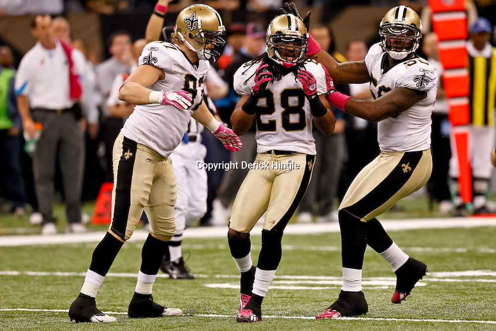 October 3, 2010; New Orleans, LA, USA; New Orleans Saints safety Usama Young (28) celebrates with linebacker Marvin Mitchell (50) and defensive end Jeff Charleston (97) following a defensive stop against the Carolina Panthers during the second half at the Louisiana Superdome. The Saints defeated the Panthers 16-14. Mandatory Credit: Derick E. Hingle