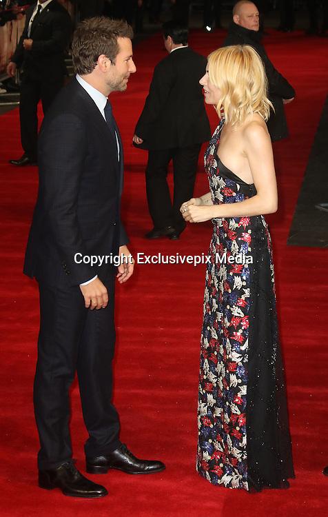 October 28, 2015 - Sienna Miller and Bradley Cooper attending 'Burnt' European Premiere at Vue West End, Leicester Square in London, UK.<br /> ©Exclusivepix Media