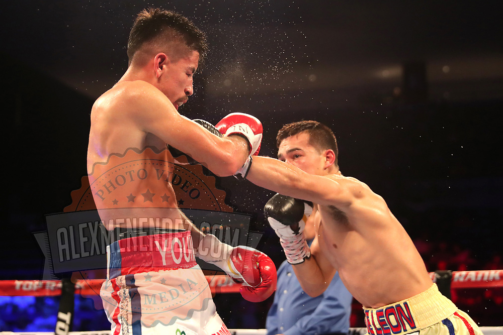 NEW ORLEANS, LA - JULY 14:  Erick DeLeon lands a shot to the face of Adrian Young during the Regis Prograis v Juan Jose Velasco ESPN boxing match at the UNO Lakefront Arena on July 14, 2018 in New Orleans, Louisiana.  (Photo by Alex Menendez/Getty Images) *** Local Caption *** Adrian Young; Erick DeLeon