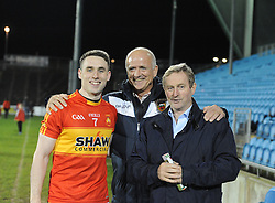 Patrick Durcan Castlebar Mitchels is congratulated by supporters John Maughan and An Taoiseach Enda Kenny TD, after their County final win over Knockmore.<br />Pic Conor McKeown