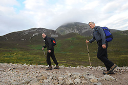 Fr. Donncha O Haodha and the Papal Nuncio, Archbishop Charles Brown on their way up Croagh Patrick for the annual pilgrimage yesterday.<br />