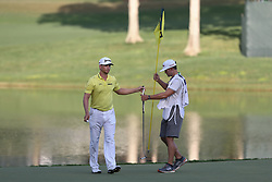 August 12, 2017 - Charlotte, North Carolina, United States - Chris Stroud hands over his putter to his caddie Casey Clendenon on the 17th green during the third round of the 99th PGA Championship at Quail Hollow Club. (Credit Image: © Debby Wong via ZUMA Wire)