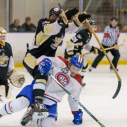 KINGSTON, - Apr 6, 2016 -  Ontario Junior Hockey League game action between Trenton Golden Hawks and Kingston Voyageurs. Game 4 of the North East Championship series.  at the Invista Centre, ON. Lucas Brown #28 of the Trenton Golden Hawks and Colin Tonge #15 of the Kingston Voyageurs get tangled up during the second period. (Photo by Ian Dixon / OJHL Images)