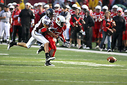 25 September 2010:  Derek Miller envelopes Tyrone Walker as the ball misses both of them on an over throw.  The Missouri State Bears lost to the Illinois State Redbirds 44-41 in double overtime, meeting at Hancock Stadium on the campus of Illinois State University in Normal Illinois.