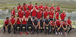 DINARD, FRANCE - Tuesday, June 7, 2016: Wales players line up for a team group photograph at the Novotel Thalasso Dinard ahead of the start of the UEFA Euro 2016 tournament. Back row L-R: Ashley 'Jazz' Richards, Emyr Huws, Paul Dummett, James Chester, Simon Church, George Williams, Jonathan Williams, David Vaughan. Middle row L-R: Andy King, James Collins, goalkeeper Daniel Ward, goalkeeper Wayne Hennessey, goalkeeper Owain Fon Williams, Sam Vokes, David Edwards, Ben Davies, David Cotterill. Front row L-R: Neil Taylor, Hal Robson-Kanu, Joe Ledley, Gareth Bale, goalkeeping coach Martyn Margetson, assistant manager Osian Roberts, manager Chris Coleman, coach Paul Trollope, captain Ashley Williams, Aaron Ramsey, Joe Allen. (Pic by David Rawcliffe/Propaganda)