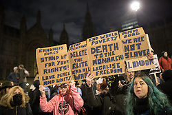 © Licensed to London News Pictures . 05/11/2016 . London , UK . Supporters of Anonymous in front of Parliament , many wearing Guy Fawkes masks , attend the Million Mask March bonfire night demonstration , at Trafalgar Square , in central London . Photo credit : Joel Goodman/LNP