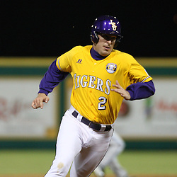 2009 February 20: LSU's Buzzy Haydel in as a pitch runner heads to third base during a NCAA baseball match up between the #1 ranked LSU Tiger and the unranked Villanova Wilcats at the newly constructed Alex Box Stadium in Baton Rouge, Louisiana..
